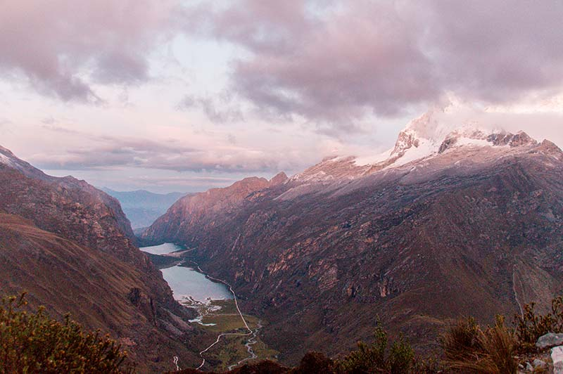 pinky sky and sunrise overlooking snowy mountains of Huascaran