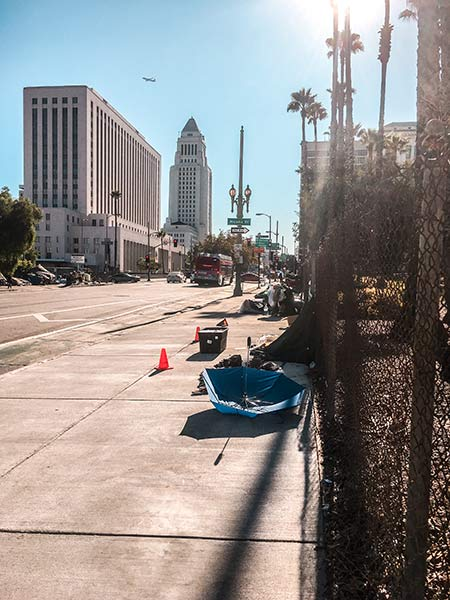 a view on the street in downtown LA with skyscrapers