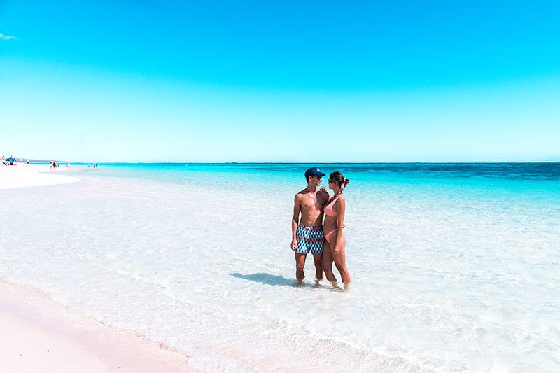two people standing in the turquoise water, white sand beach near Exmouth in Western Australia