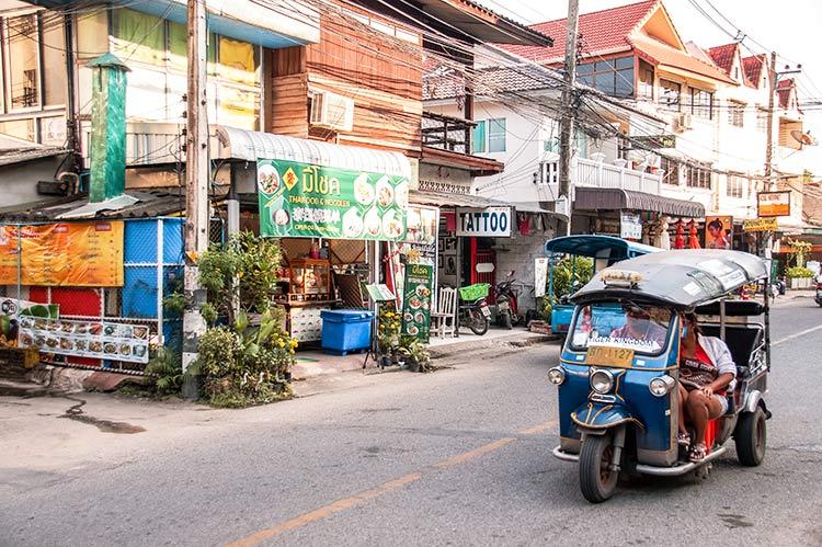tuk tuk driving on the road in Chiang Mai