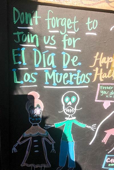 A board with El Dia de Los Muertos