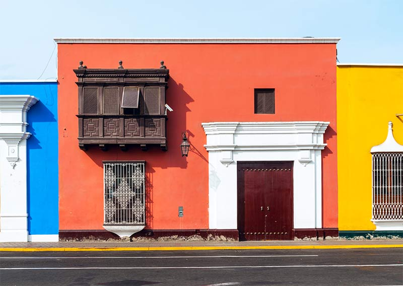 red, blue and yellow house in Trujillo, Peru