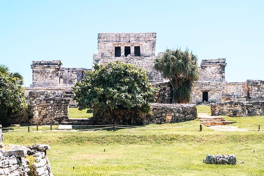a view on grey El Castillo, made our of stone, green grass and bush