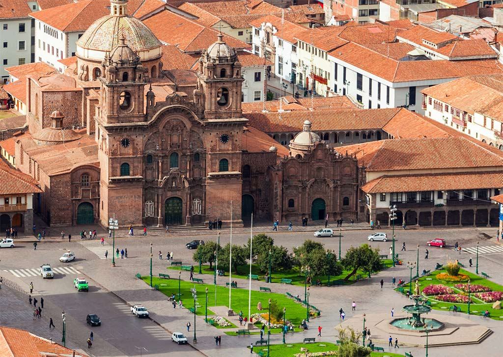 a view on brown church in plaza de armas and best places to stay in Cusco.