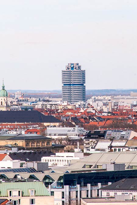 view over the several roofs with the BMW headquarters in the background