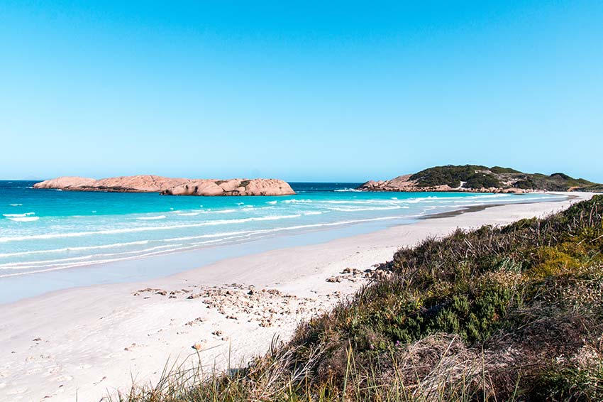 white sand beach, blue water and green hills in Esperance