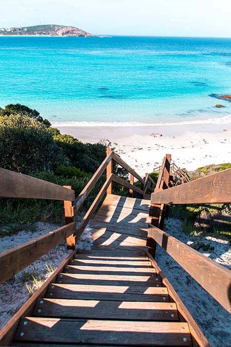 wooden staircase, blue water and white sand beach in Esperance, Western Australia