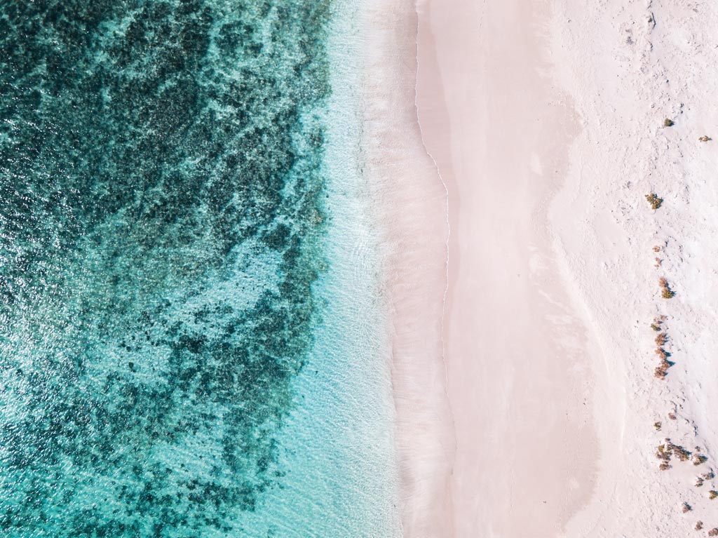 australian white sand beach with blue water near Coral bay