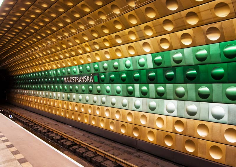 brown and green dots inside of the subway in Prague, which in an unique photo spot