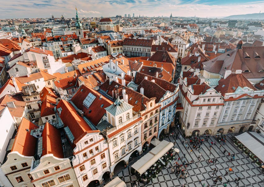 an arial view on the buildings with red roofs over Prague