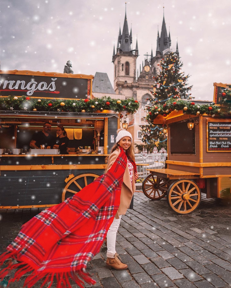 woman with red scarf and food stall at Christmas market which is the best photography spots in Prague