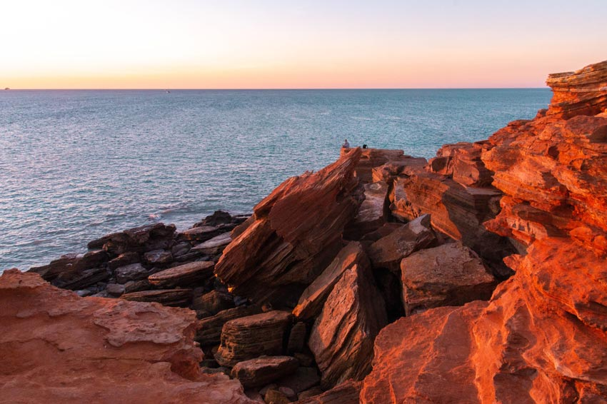 red cliffs and view on a blue water